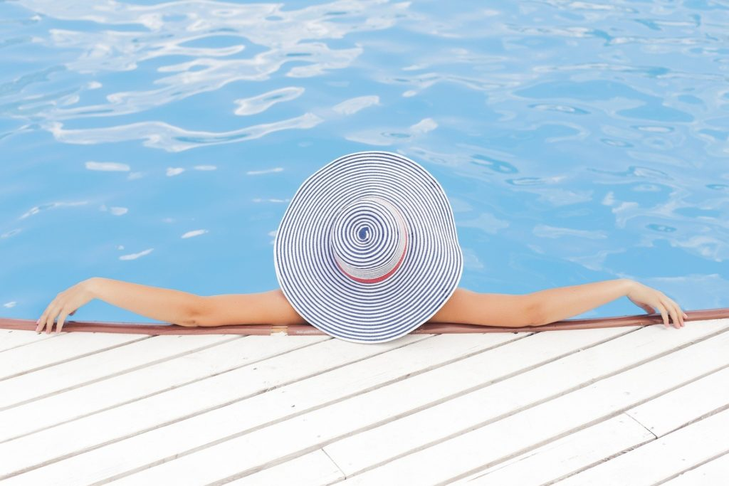 A woman relaxing at a swimming pool